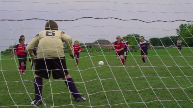 ws pan boy playing soccer, scoring a goal / rockford, illinois, usa - scoring stock videos & royalty-free footage