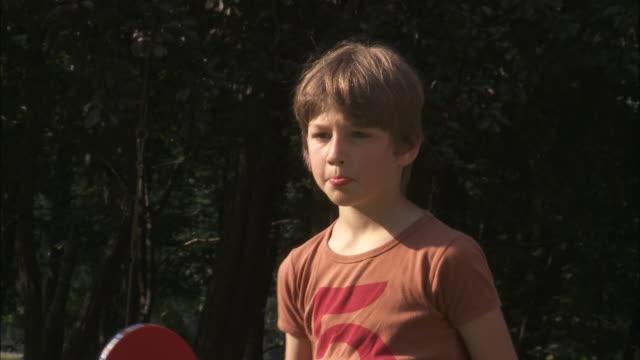 cu boy (10-11) playing table tennis, bouillon, belgium - table tennis bat stock videos & royalty-free footage