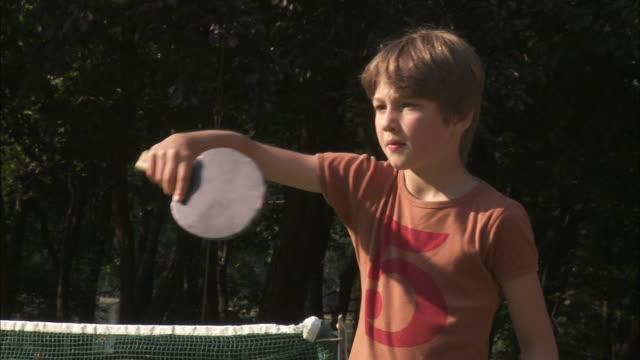 ms boy (10-11) playing table tennis, bouillon, belgium - table tennis bat stock videos & royalty-free footage