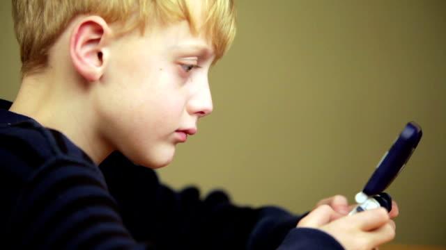 boy playing video game - handheld video game stock videos & royalty-free footage