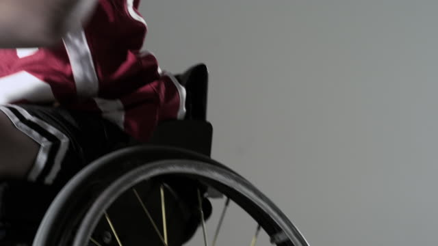 boy playing wheelchair basketball - wheelchair basketball stock videos and b-roll footage