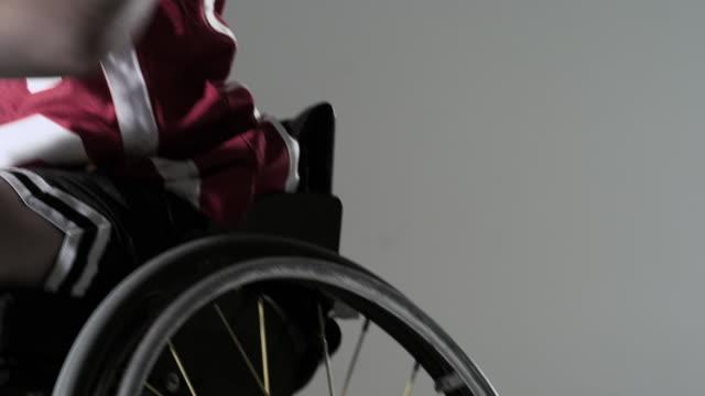 boy playing wheelchair basketball - wheelchair basketball stock videos & royalty-free footage