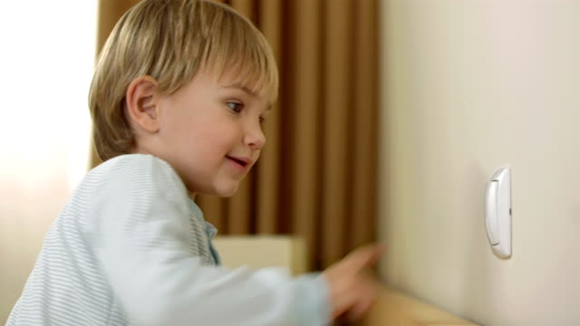 boy playing with a light switch - start or stop button stock videos & royalty-free footage