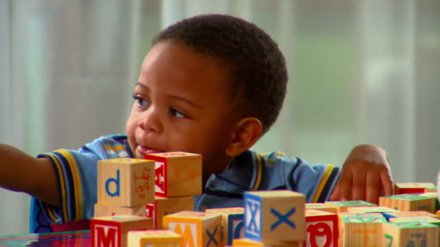 CU, TU, Boy (12-17 months) playing with alphabet blocks, Richmond, Virginia, USA