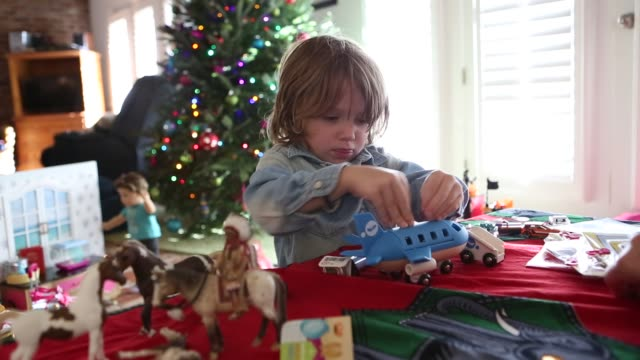 boy playing with Christmas gift