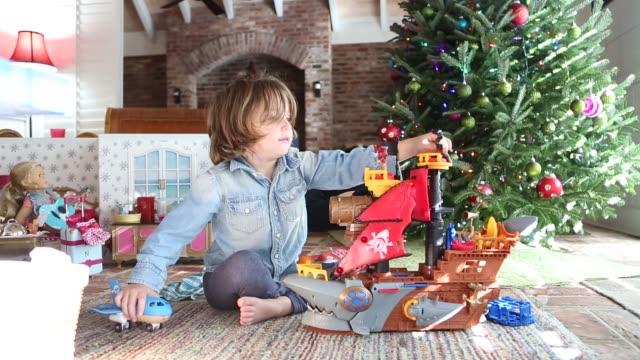 boy playing with Christmas gift