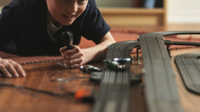 cu tu boy (10-11) playing with electric slot cars / orem, utah, usa. - radio controlled handset stock videos and b-roll footage