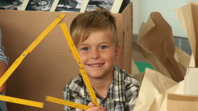 hd: boy playing with folding ruler - diy stock videos & royalty-free footage