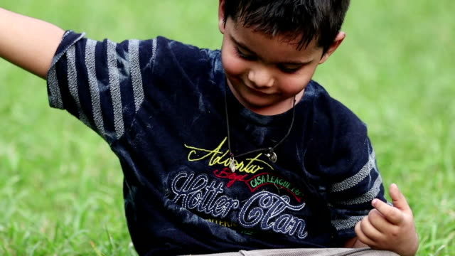 boy playing with grass - video portrait stock videos & royalty-free footage
