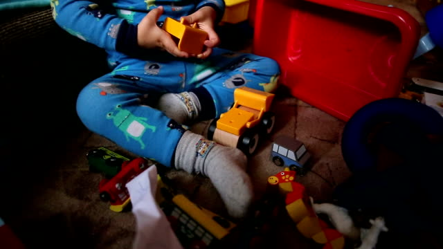 boy playing with his favorite toy cars - leisure games stock videos & royalty-free footage