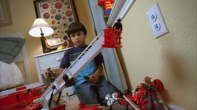 ms zi zo slo mo boy playing with toys next to wall outlet / kyle, texas, usa - plug socket stock videos and b-roll footage
