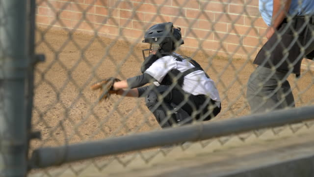 boy plays catcher in a little league baseball game. - little league stock videos and b-roll footage