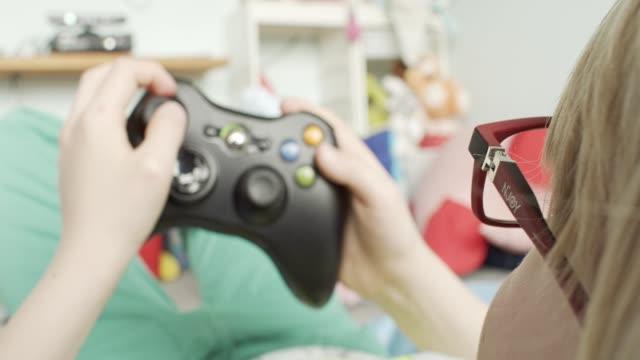 pojke spelar konsol - computer game control bildbanksvideor och videomaterial från bakom kulisserna