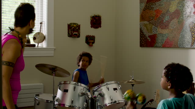 boy plays drums with mom and sister - drum kit stock videos & royalty-free footage