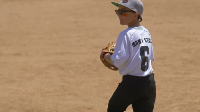boy plays pitcher in a little league baseball game. - baseball pitcher stock-videos und b-roll-filmmaterial