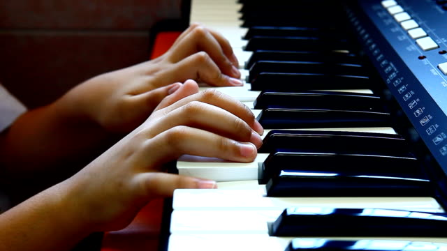 boy plays the piano. - training course stock videos & royalty-free footage