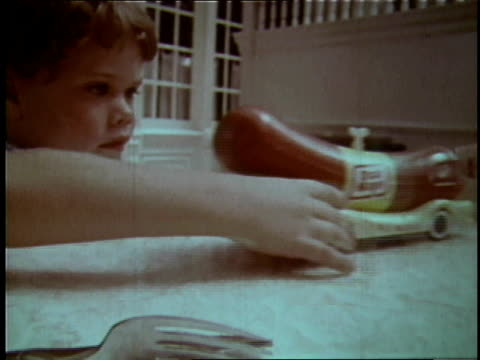 1970 boy plays with oscar mayer wienermobile on tabletop  - bordsyteinspelning bildbanksvideor och videomaterial från bakom kulisserna