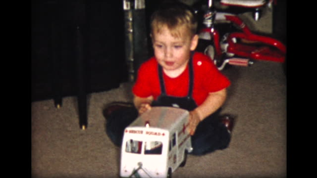1957 boy plays with Xmas toy truck