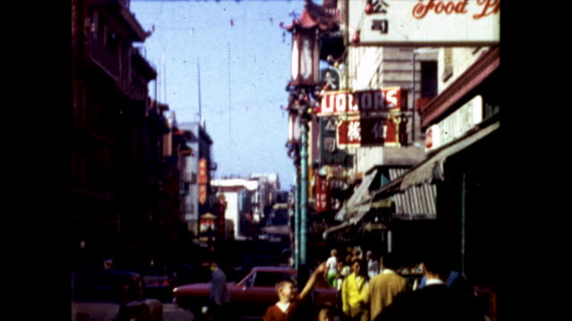 boy points to a sign in san francisco chinatown in 1960s - chinatown stock videos & royalty-free footage