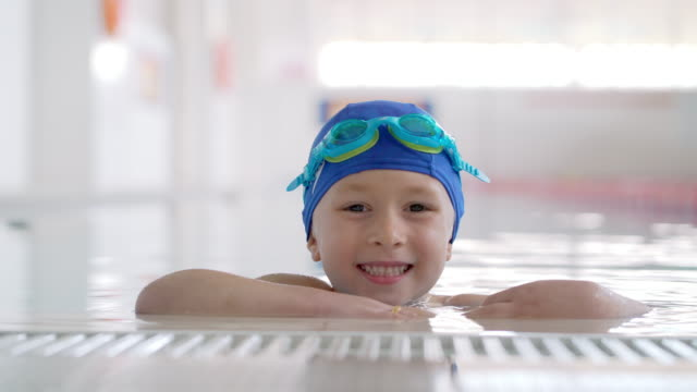 boy posing in the swimming pool - swimming goggles stock videos & royalty-free footage