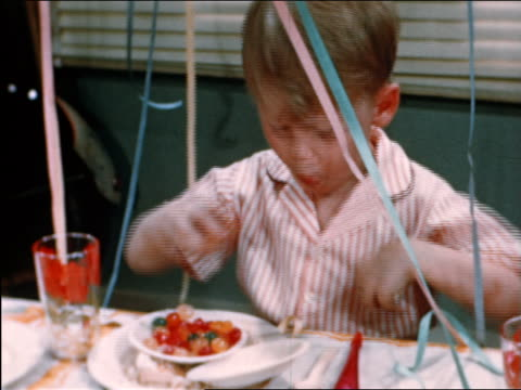 stockvideo's en b-roll-footage met 1946 boy putting candy into pockets at party / industrial - 1946