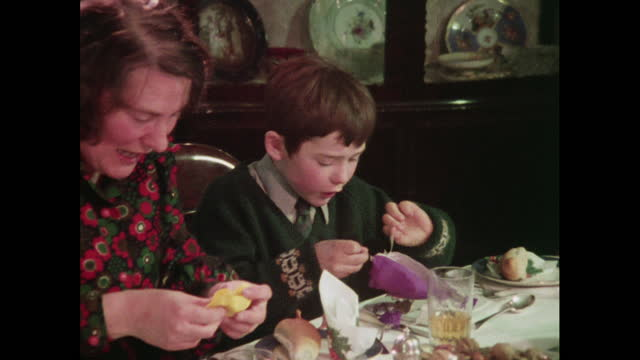 a boy reads jokes from a christmas cracker - cracker stock videos & royalty-free footage