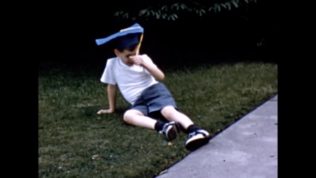 1957 boy relaxing on front lawn - reclining stock videos & royalty-free footage