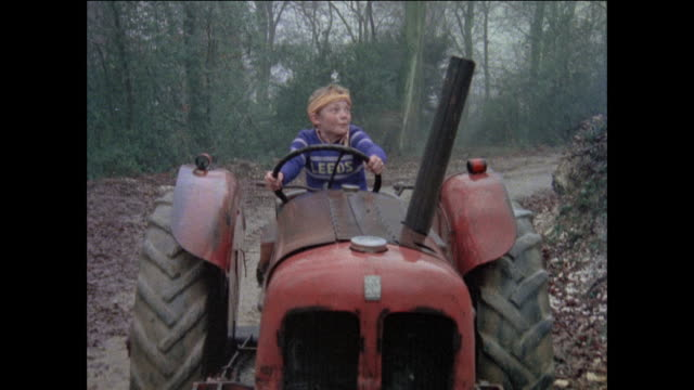 vidéos et rushes de montage boy releasing brake on tractor and screaming for help while rolling down hill / united kingdom - tracteur