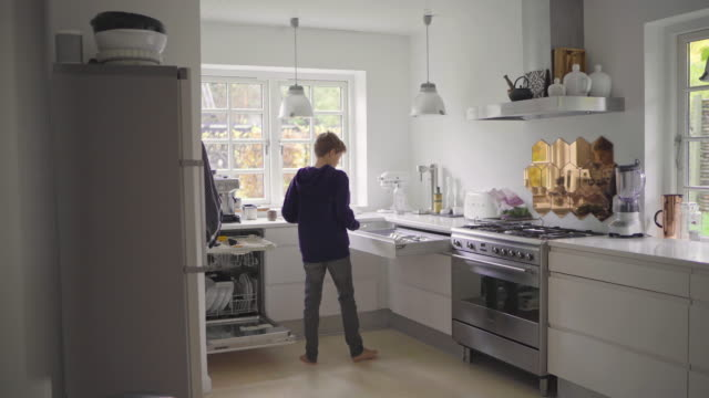 boy removing cutlery from dish washer - drawer stock videos & royalty-free footage