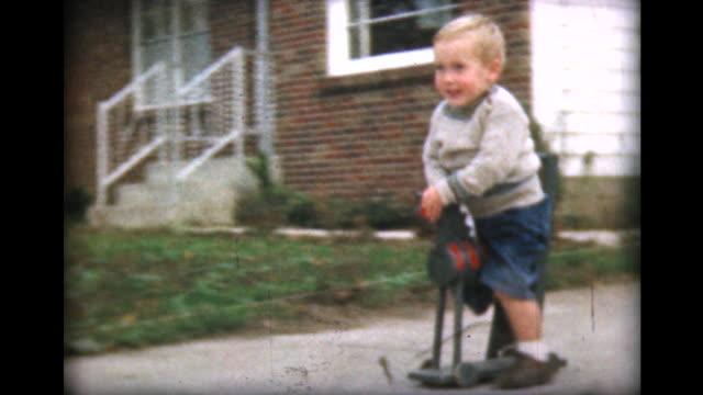 1957 boy rides green hobby horse - joy stock videos & royalty-free footage