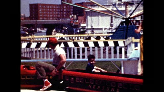"""vidéos et rushes de boy rides mini-train at amusement park that reads """"city of asbury park"""" and """"neptune"""" - new jersey"""
