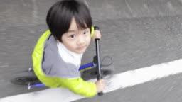 Boy riding a bicycle.