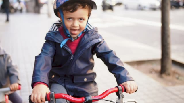 boy riding a bike - western europe stock videos & royalty-free footage