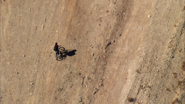aerial ws ts boy riding bike from desert into suburbs, with cityscape / las vegas, nevada, usa - 50 seconds or greater stock videos & royalty-free footage