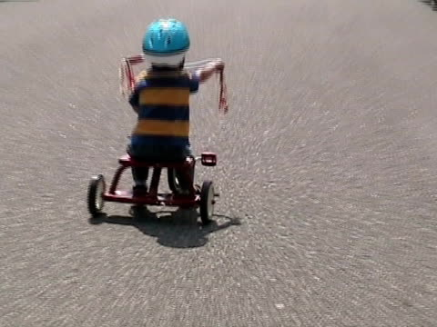 ms, zi, boy (2-3) riding tricycle on street, rear view, simi valley, california, usa - tricycle stock videos & royalty-free footage
