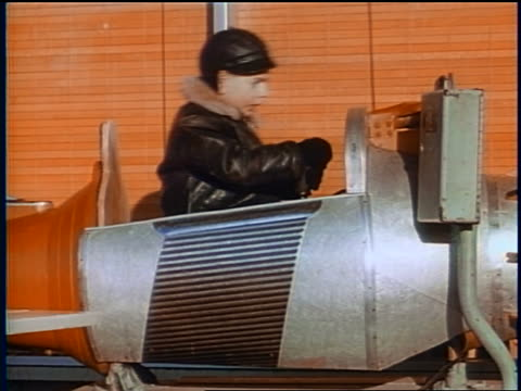 1958 boy rocking back + forth on coin operated ride outdoors / newsreel - 1958 stock videos & royalty-free footage