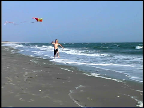 boy running and flying kite on beach - see other clips from this shoot 1335 stock videos and b-roll footage