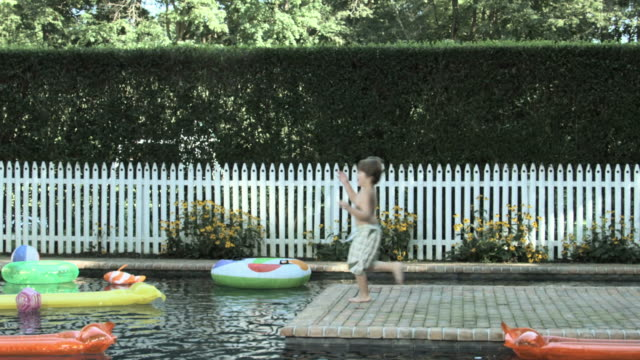 boy running and jumping into swimming pool, slow motion - entstehung stock-videos und b-roll-filmmaterial
