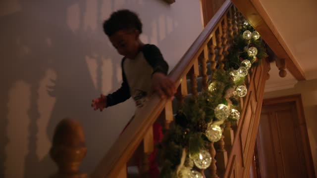Boy running down stairs