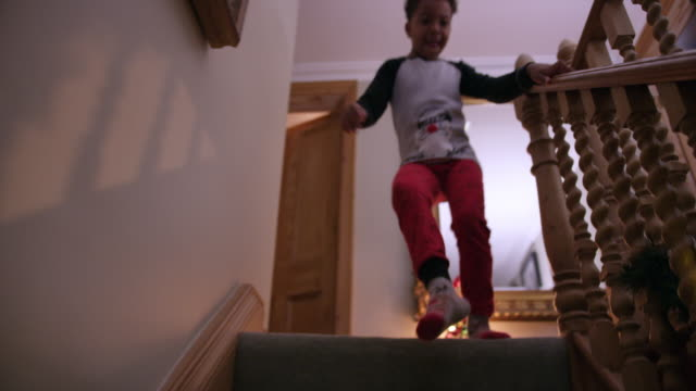 boy running down stairs - pyjamas stock videos & royalty-free footage