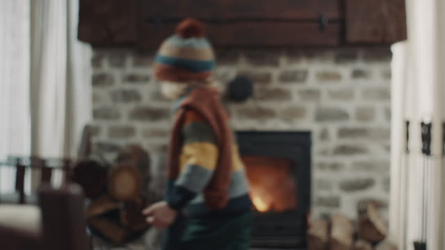 boy running in front of the fireplace - warming up stock videos & royalty-free footage