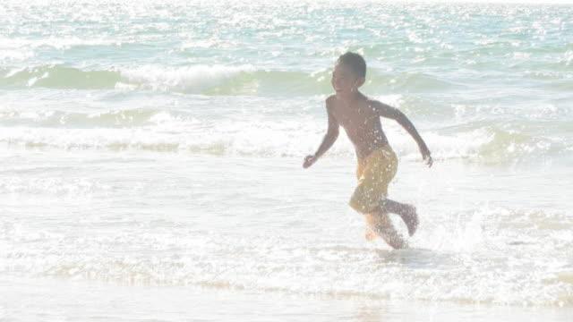 Boy running on shore