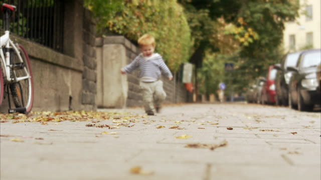 A boy running on the pavement Sweden.