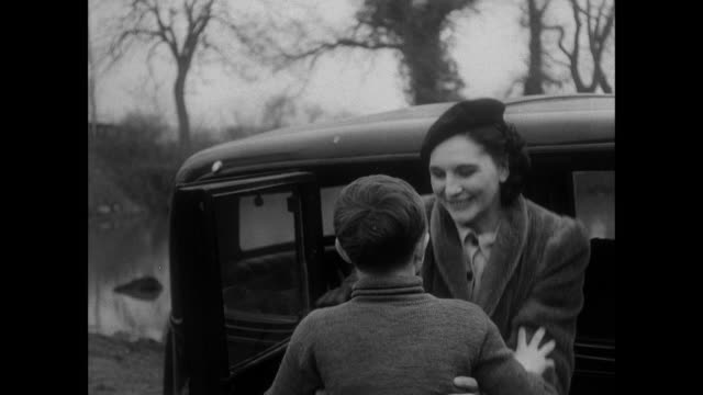 montage boy running out of house to greet his parents at the car / east anglia, united kingdom - 1940 stock videos & royalty-free footage