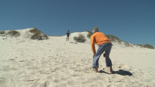WS Boy(4-5) running towards grandfather / Cape Town, South Africa