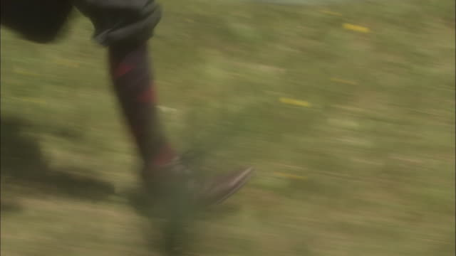 a boy runs through grass while wearing knickers. - knickers stock videos & royalty-free footage
