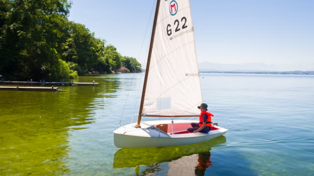 ws boy sailing small sailboat - one teenage boy only stock videos & royalty-free footage