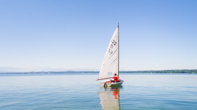 ws boy sailing small sailboat - sailing stock videos & royalty-free footage