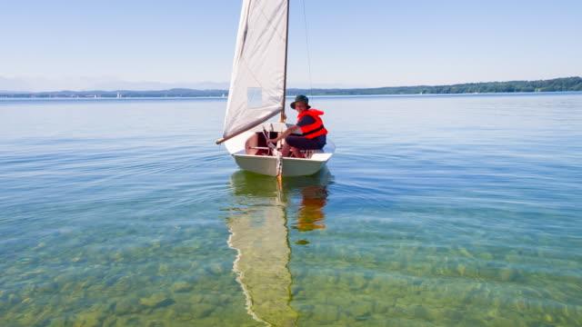 WS boy sailing small sailboat