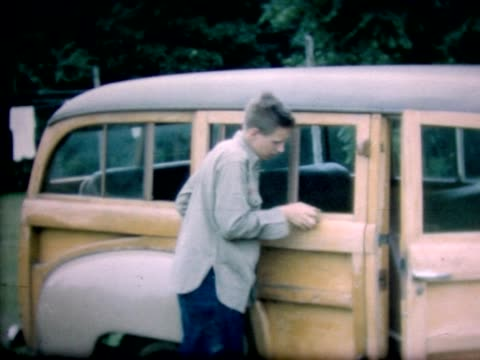 1947 boy sanding wood-paneled station wagon - sand paper stock videos and b-roll footage